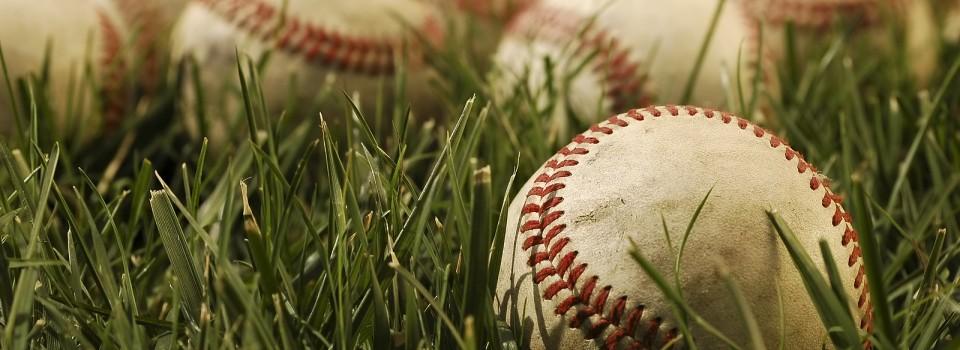 baseballs lying in grass