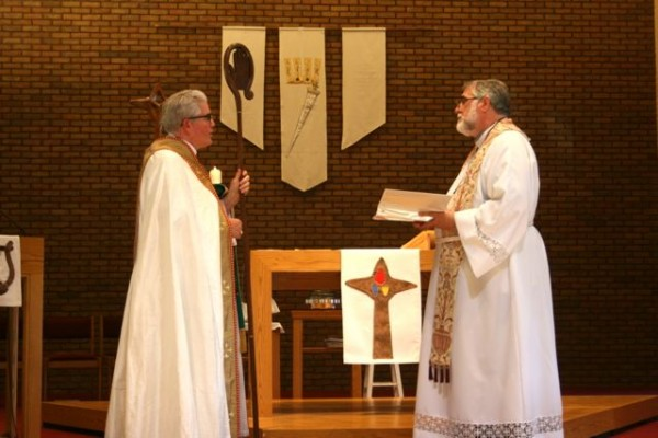 image of Bishop Saterlee and Pastor Blank facing each other