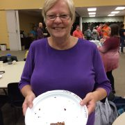 image of Pastor Marcy holding plate with a chocolate frosted brownie on it