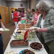 image of people gathered around food table