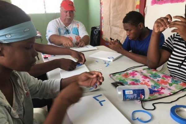 Scott Spencer doing crafts with Dominican Republic kids
