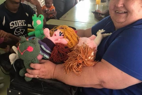 Becky Spencer holding puppets