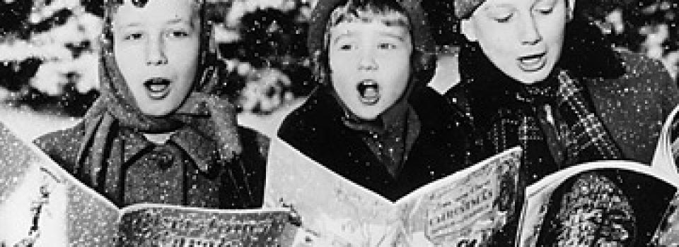 three young children singing christmas carols